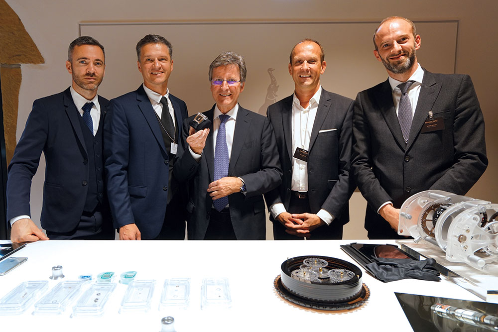 Michael Parmigiani (center) and the Parmigiani Fleurier team