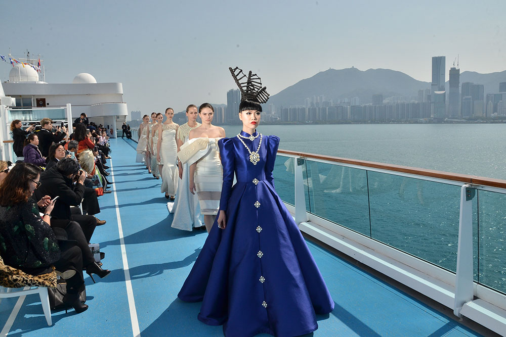 Jessica Minh Ahn leads a pack of models aboard the ship