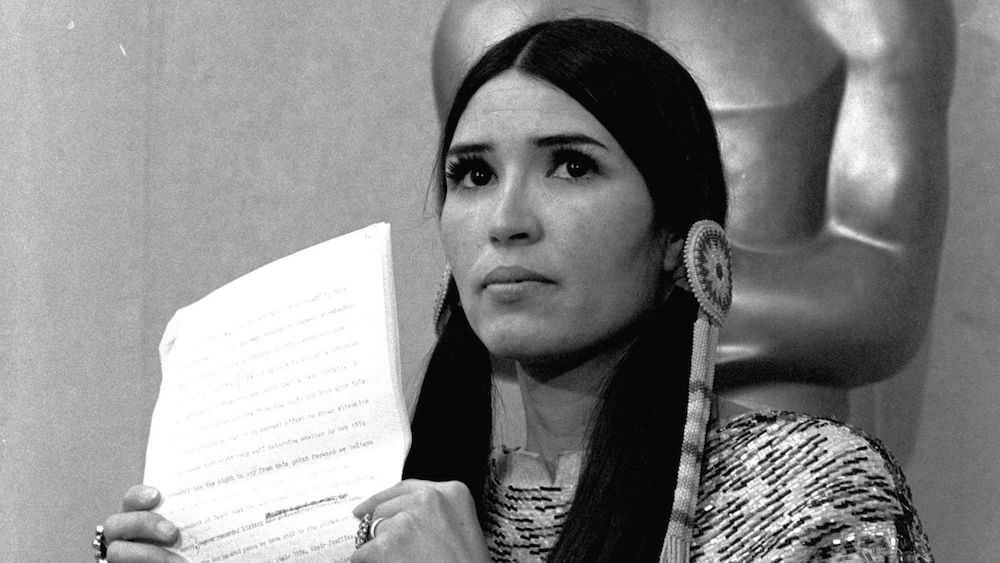 Native American activist Sacheen Littlefeather reads a letter on behalf of Marlon Brando on the stage of the 1973 Oscars