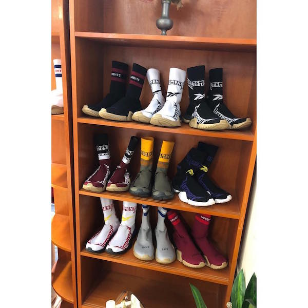 "A shelf filled with Sock Sneakers with the caption ""#VETEMENTSxREEBOK FALL-WINTER 2019 PREVIEW"