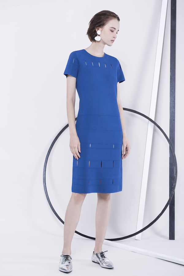 Slashes create a subtle peek-a-boo pattern in this electric blue shift dress