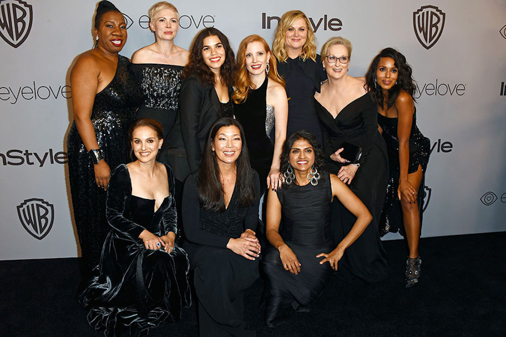 Celebrities and activists wearing black in support of the Times' Up movement on the 2018 Golden Globes Red Carpet