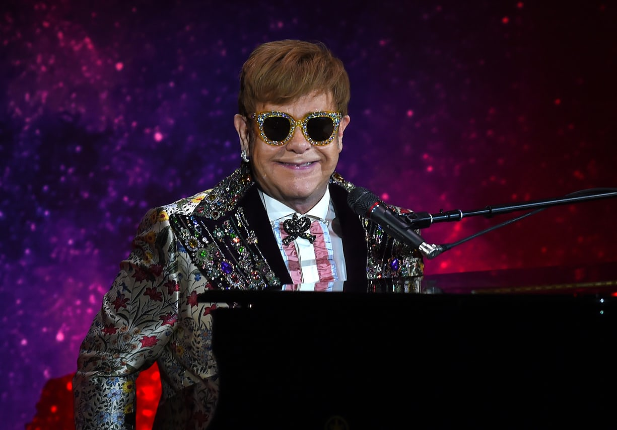 Elton John dressed in Gucci at the press conference for his farewell tour (Photo: Timothy A. Clary/AFP/Getty Images)