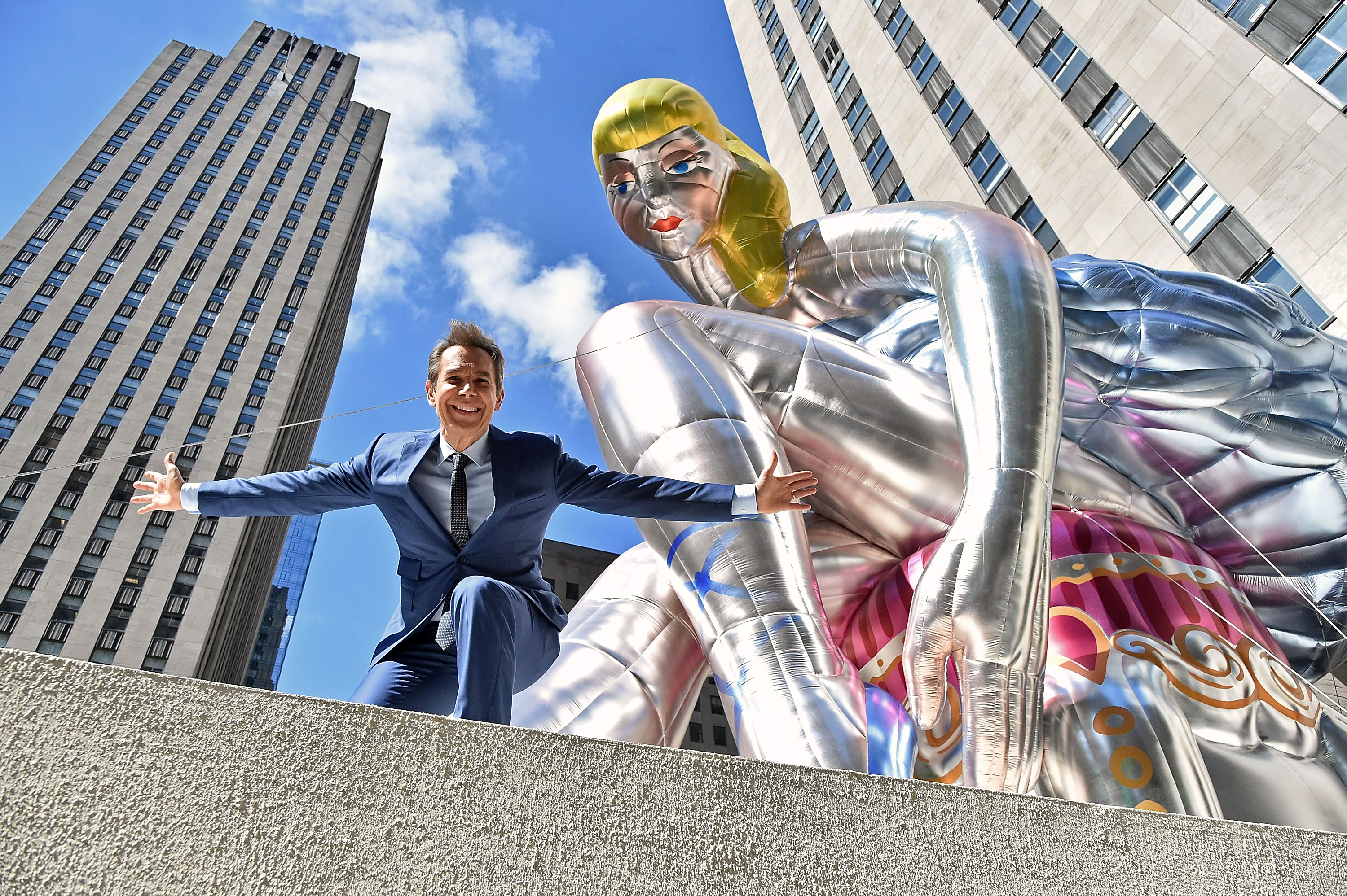 Jeff Koons with Seated Ballerina, a public art project at the Rockefeller Center in New York City.