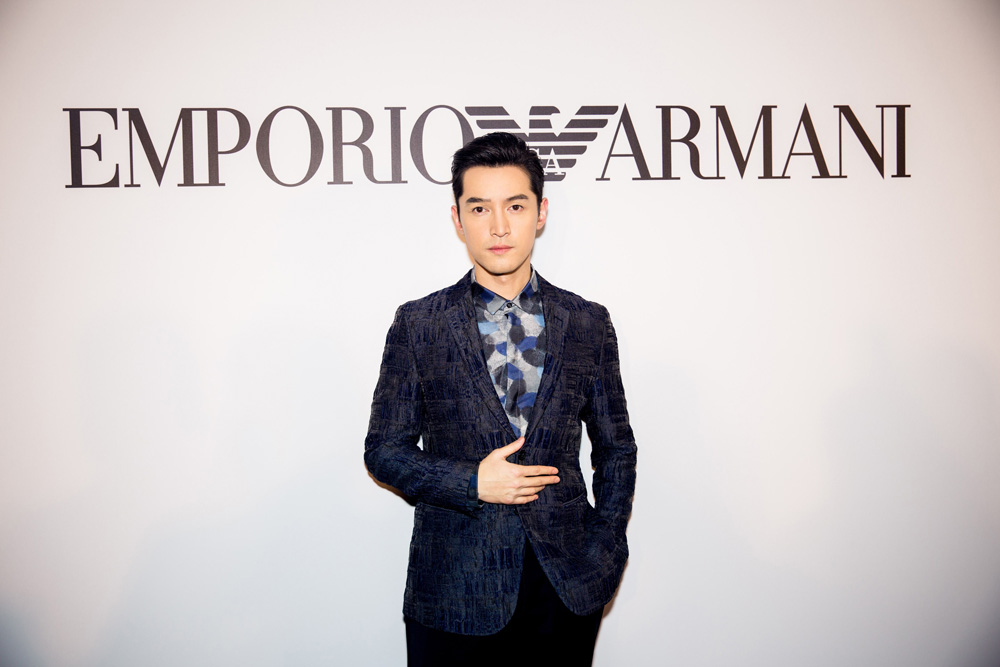 Hu Ge poses at the Emporio Armani event