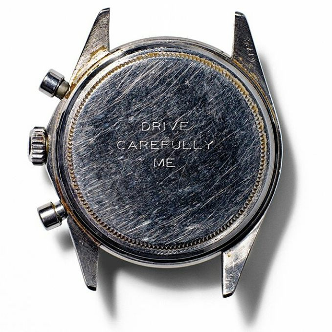 The back of the watch engraved with Drive Carefully Me from Newman's wife