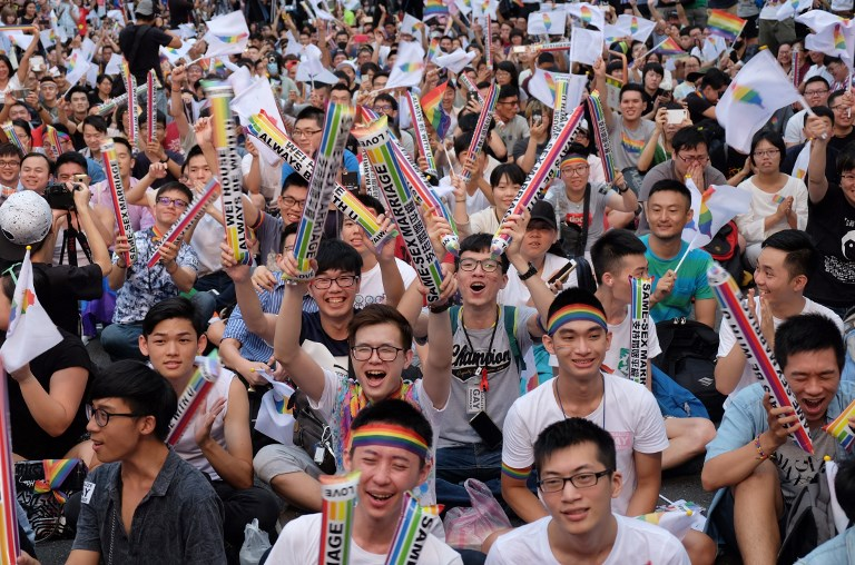Same-sex activists celebrate outside of the parliament in Taipei yesterday, as Taiwan became the first place in Asia to legalise gay marriage (photo by Sam Yeh | AFP)
