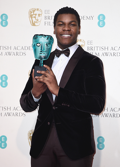 John Boyega chose to wear a custom Giorgio Armani chocolate brown two-button shawl collar tuxedo matched with a chocolate brown bow tie (Credit: Ian Gavan)