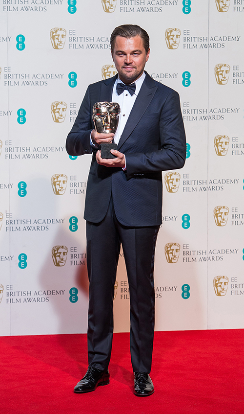 Leonardo DiCaprio at the BAFTA awards in a Giorgio Armani midnight blue tuxedo (Credit: Samir Hussein)