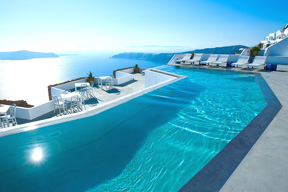 ... picturesque setting of Imerovigli, surrounded by the island's  distinctive white sugar-cube houses. The hotel's infinity pool, the largest  in Santorini, ...