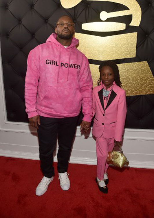 Schoolboy Q and his daughter (photo c/o AFP)