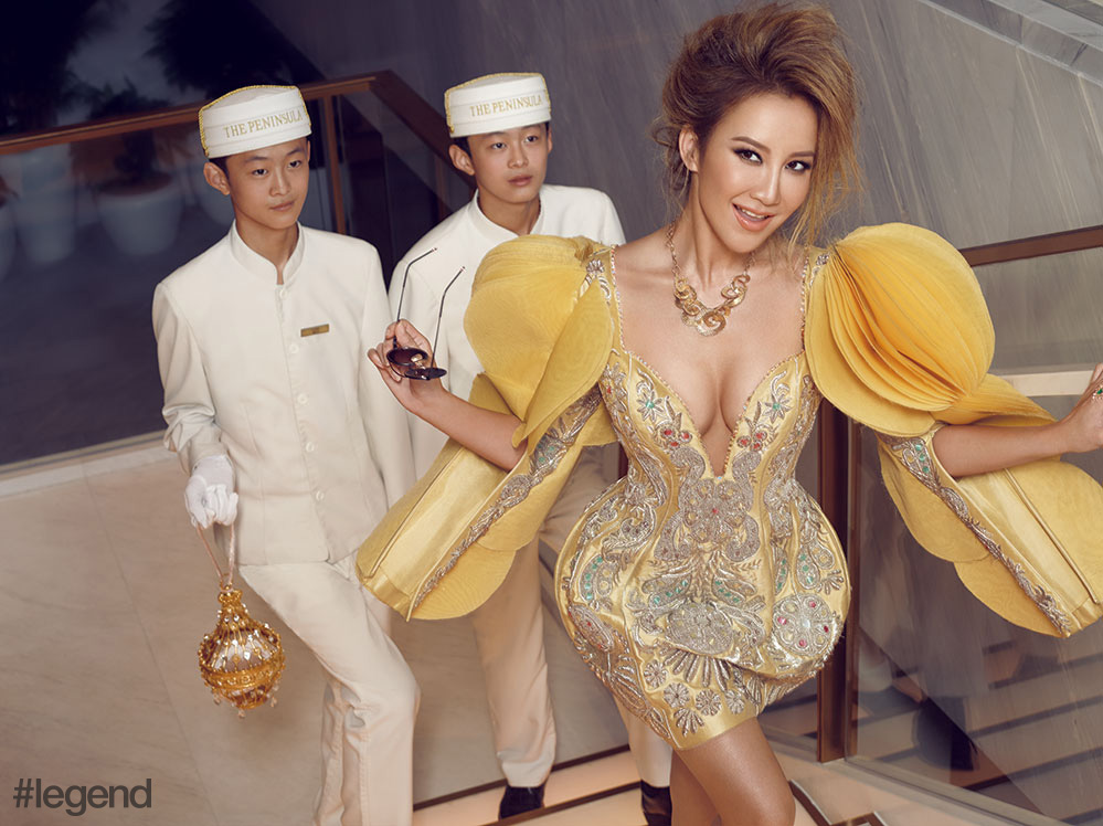 CoCo Lee wears outfit and bag by Guo Pei, sunglasses by Thom Browne, and jewellery by Sunfeel