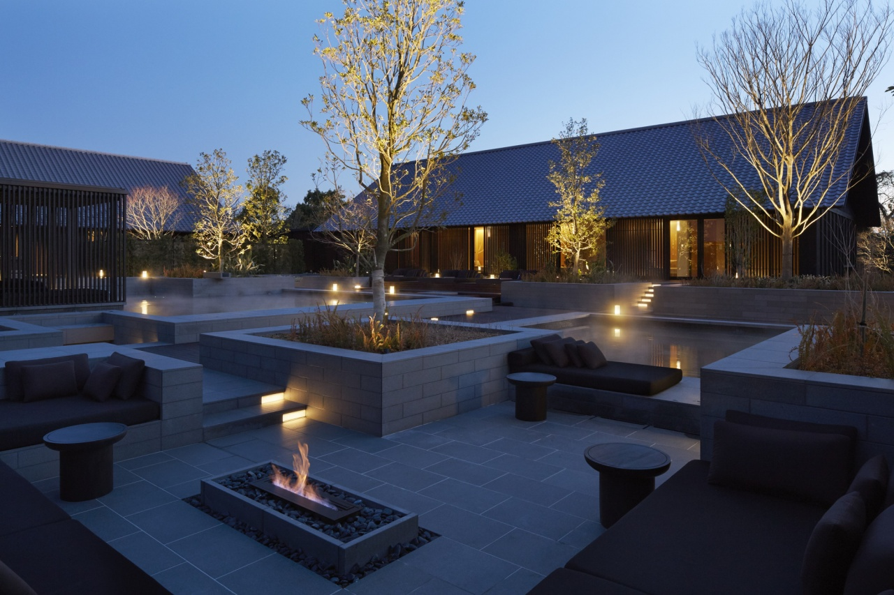 The resort's spa garden, onsen, daybeds and fireside lounge