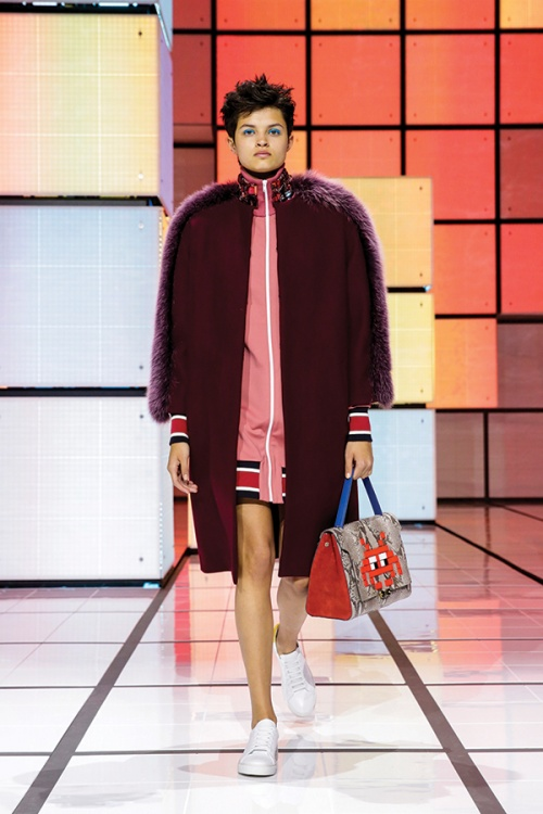 A look from the Anya Hindmarch autumn/winter runway show featuring pixel-themed items