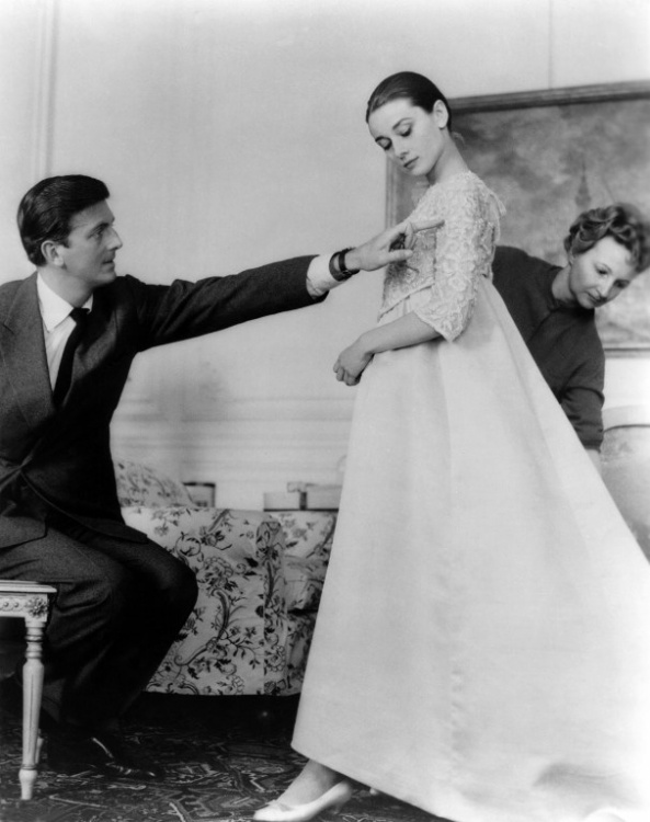 Hubert de Givenchy in the 50's, costume designer, with Audrey Hepburn (Credit: AFP Photo)