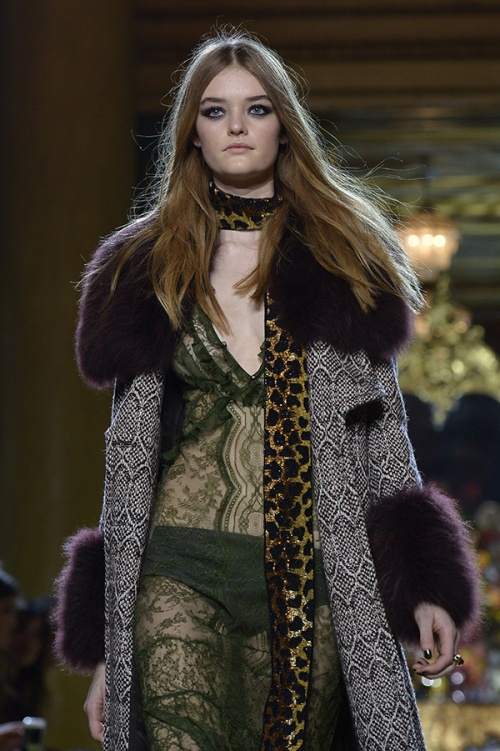 Roberto Cavalli goes wild with animal-print scarves and coats (Credit: Tiziana Fabi / AFP)