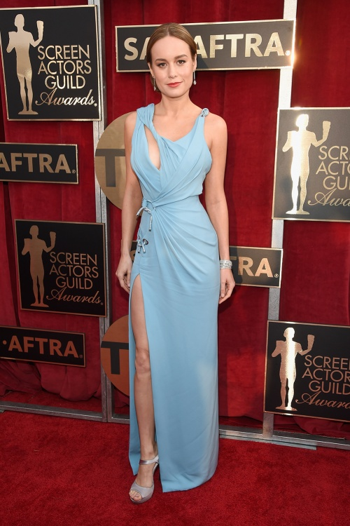 Brie Larson wearing a pale blue silk gown with cut out details by Atelier Versace