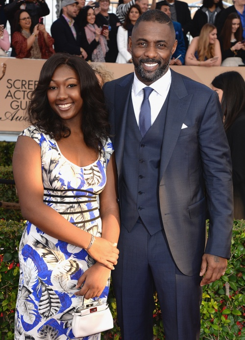 Idris Elba, with daughter Isan Elba, wearing a made-to-measure three-piece suit by Ermenegildo Zegna at the SAG Awards 2016