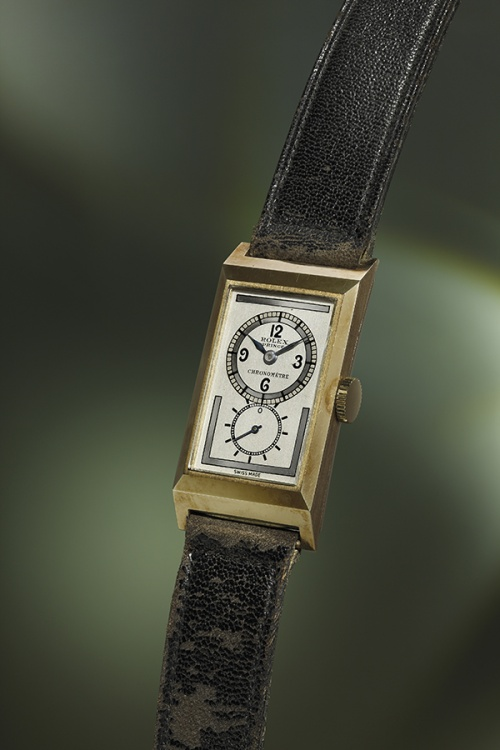 The Prince is a rare 9k yellow gold rectangular wristwatch with three-tone silvered dial