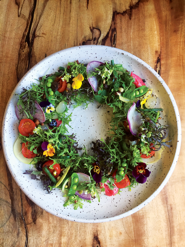 Edible lei of flowers and salad