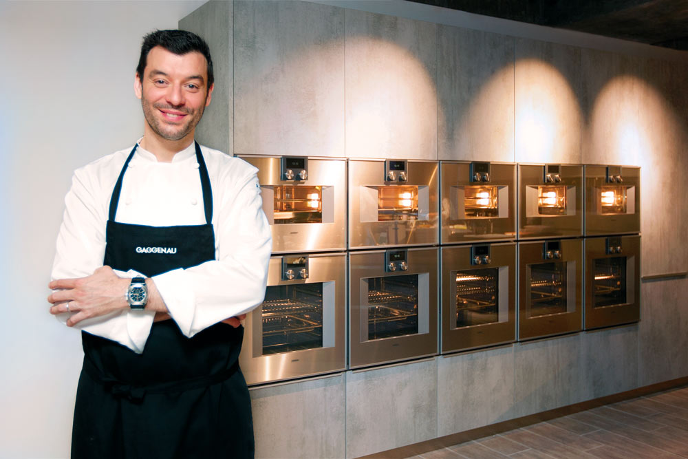 Chef Fantin with the Gaggenau combi-steam oven (Photo by Carol Chan)