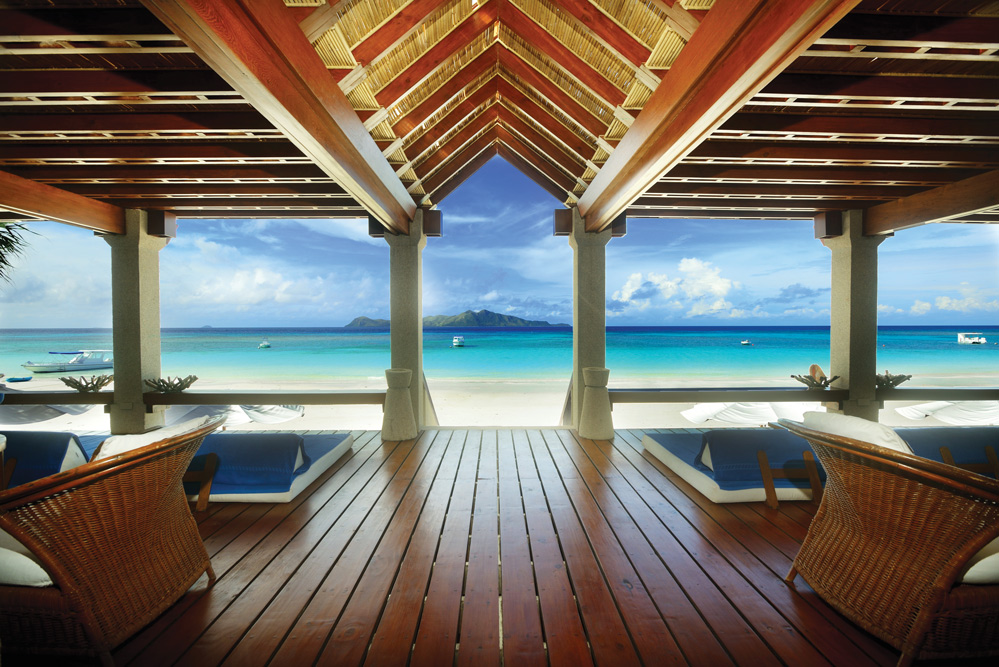 The cerulean sky and turquoise sea as seen from the beach club at Amanpulo in the Philippines