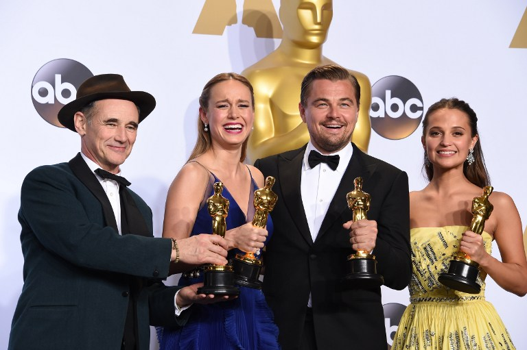 Best Supporting Actor Mark Rylance, Best Actress Brie Larson, Best Actor Leonardo DiCaprio and Best Supporting Actress Alicia Vikander pose with their Oscar in the press room during the 88th Oscars in Hollywood on February 28, 2016 (Credit: Robyn Beck / AFP)