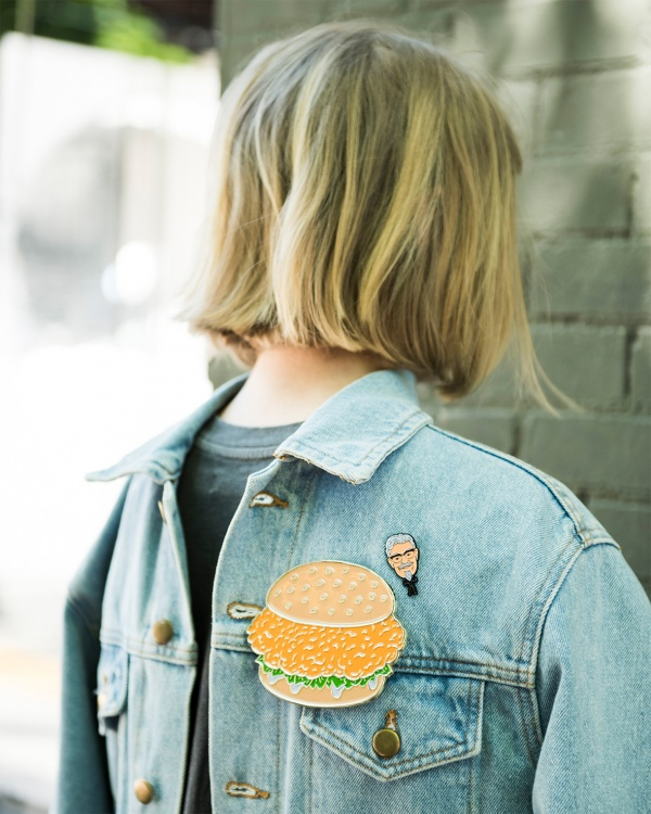 Ironically wear a denim jacket backwards with a life-sized pin of a chicken burger and wait for the street style photographers to come swarming in.