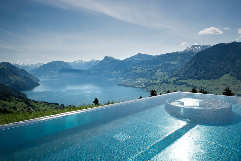 Take in the views of Lake Lucerne from an edge-free swimming pool