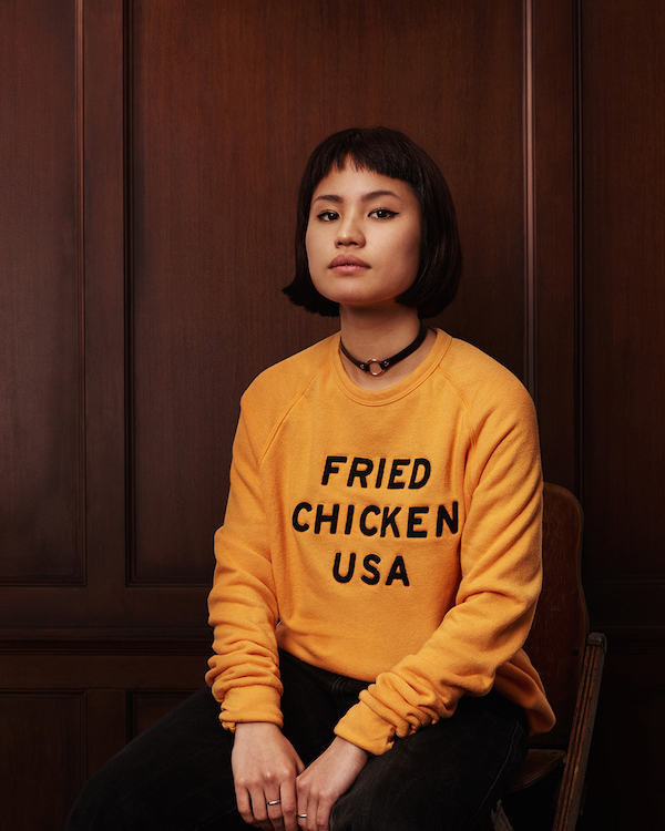 Obviously the only way to style a fried chicken coloured sweater is with a tasteful choker.