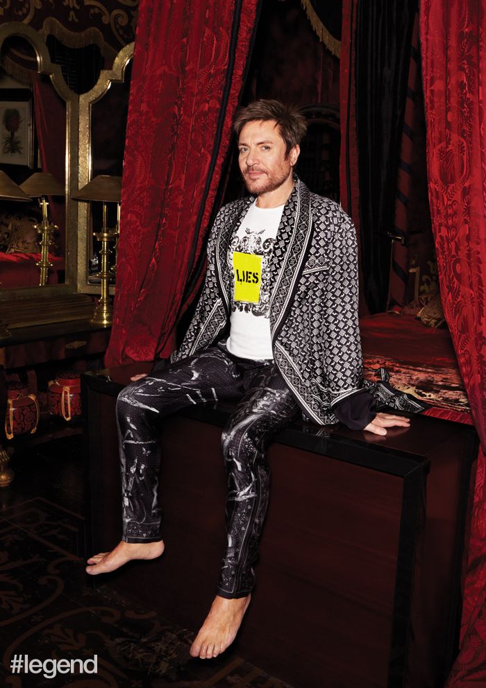 Simon wears robe and pyjama trousers by Dolce & Gabbana