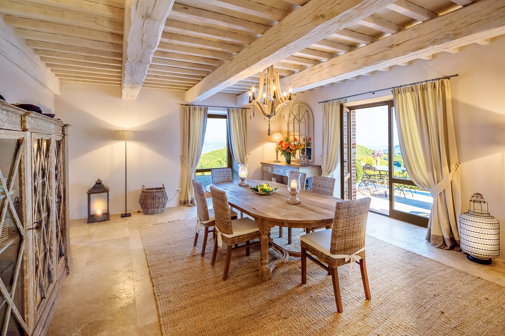 The dining room exudes a countryside calmness at Villa Santa Croce