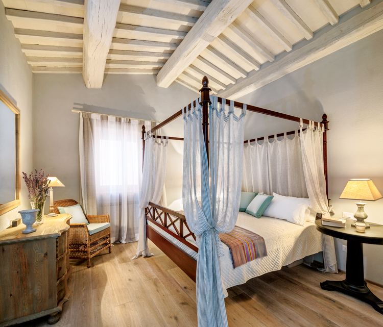 Bedroom featuring a four-poster bed at Villa Santa Croce