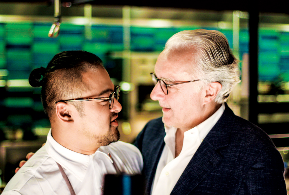 Ho Lee Fook's chef Jowett Yu shares an embrace with the legendary Alain Ducasse