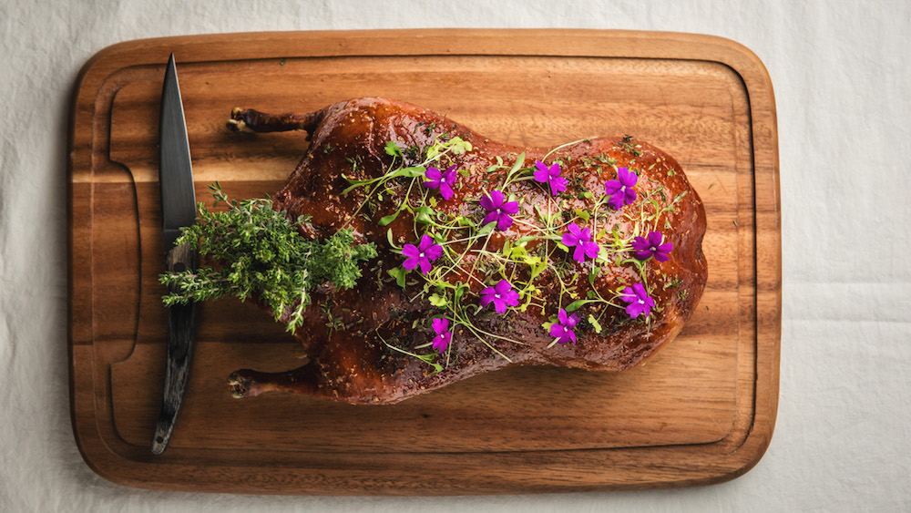 Whole roasted challans duck with spiced orange glaze, a more traditionally French dish