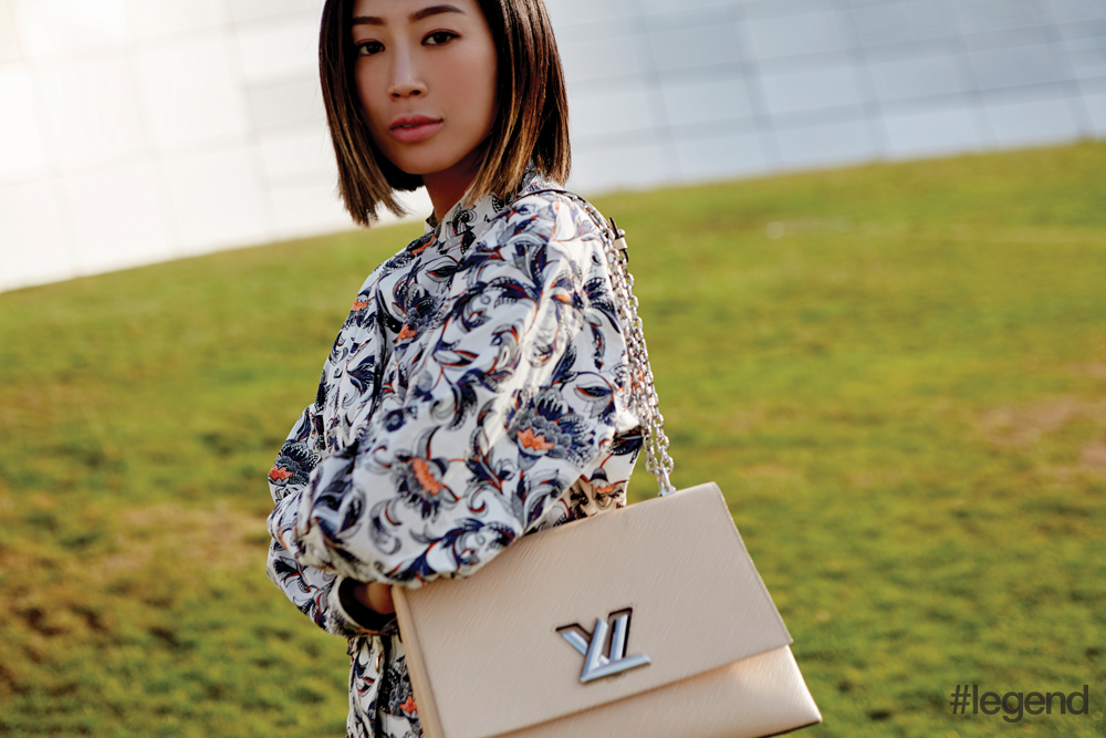 Aimee Song poses in Louis Vuitton