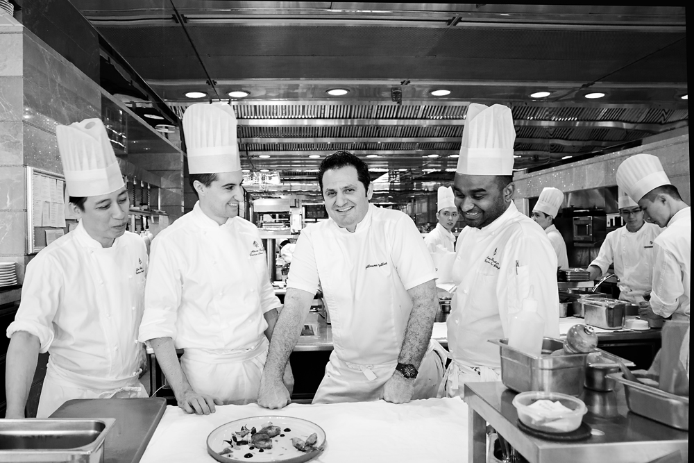 Chef Guillaume Galliot surrounded by his team