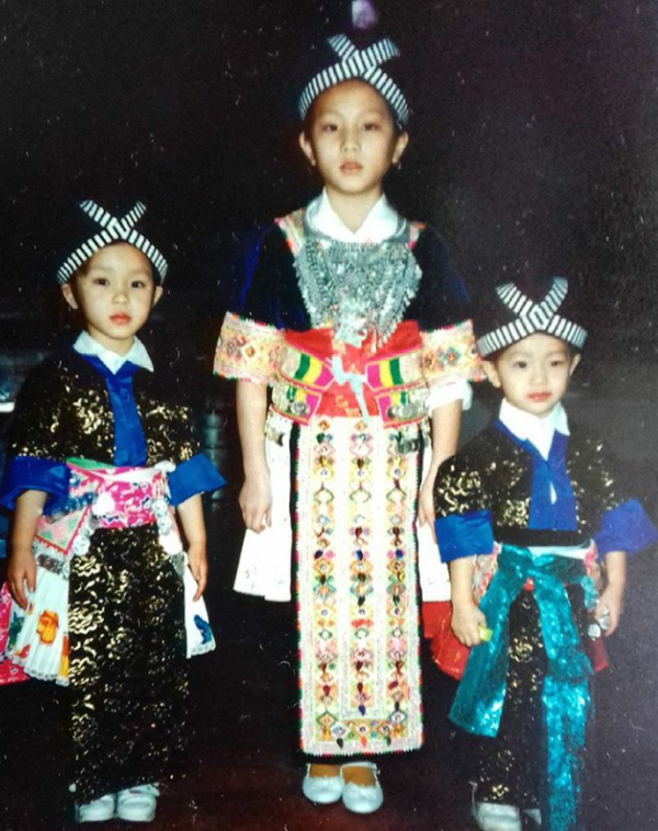 Thao and her sisters wearing traditional Hmong clothes