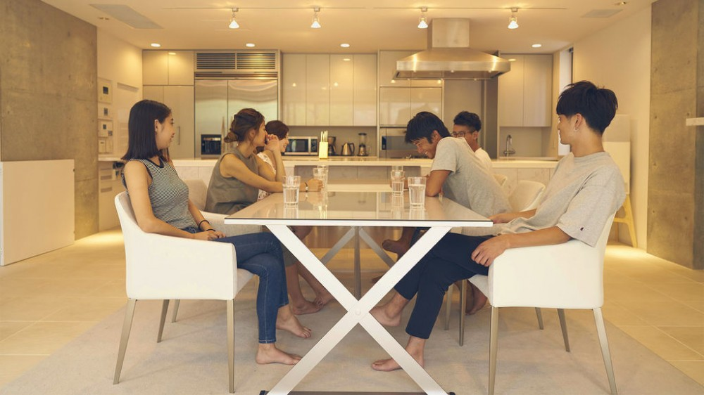 The roommates at the dining table in the Tokyo luxurious house.