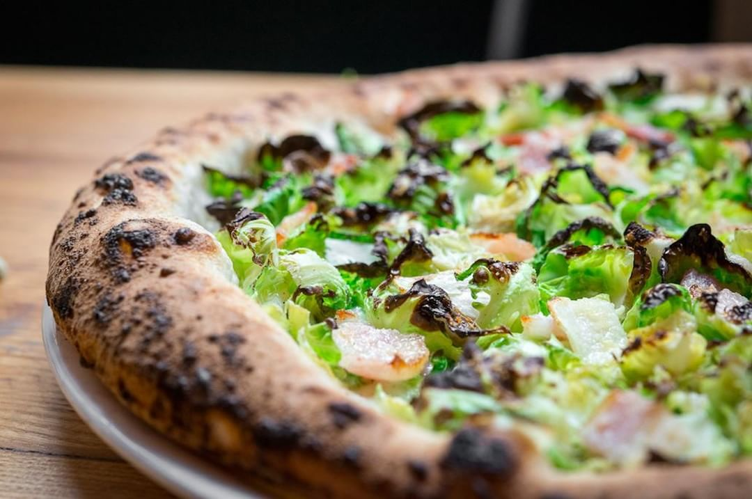 Order Motorino's Brussels sprouts pizza minus the ham for your daily dose of greens and fibre