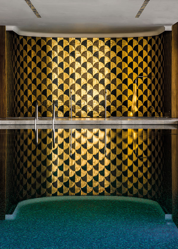 The vitality pool with real gold mosaic at the Bulgari Spa