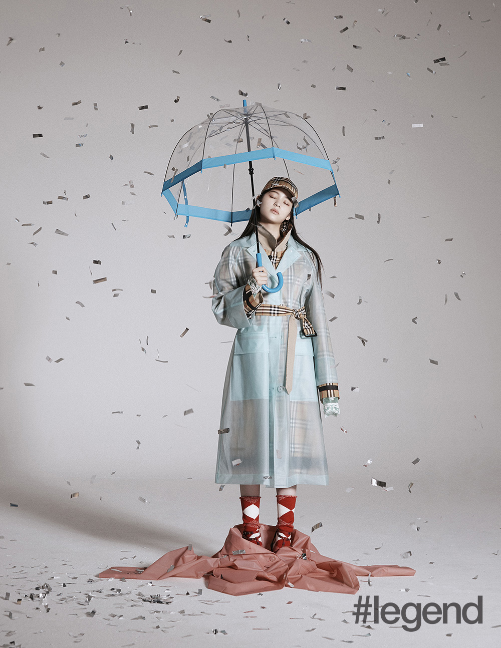 We're obsessed with Burberry's matching umbrella and trenchcoat