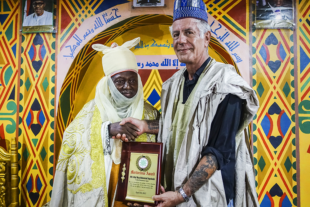 Bourdain receives a meritorious award from HRH Alhaji Musa Muhammed Dogon Kadai after filming in Lagos, Nigeria