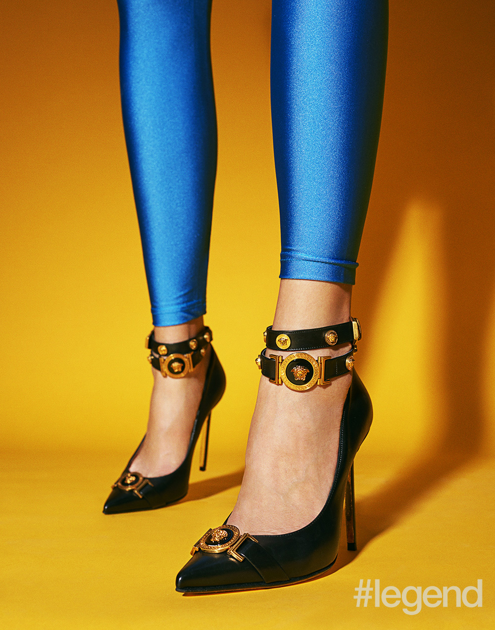 Shoes by Versace and leggings are stylist's own