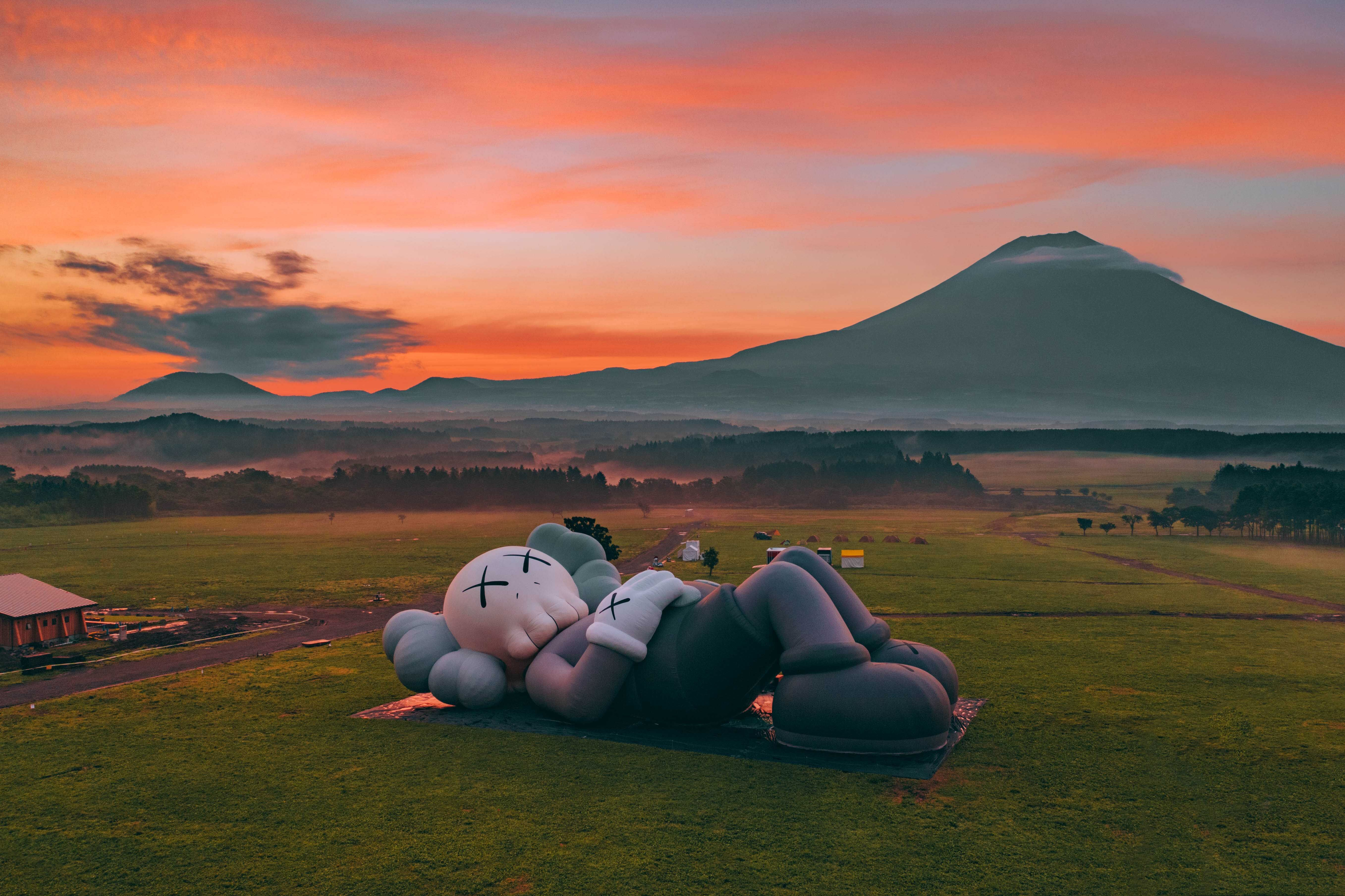Aerial drone shot of the Kaws: Holiday sculptural piece at Mount Fuji