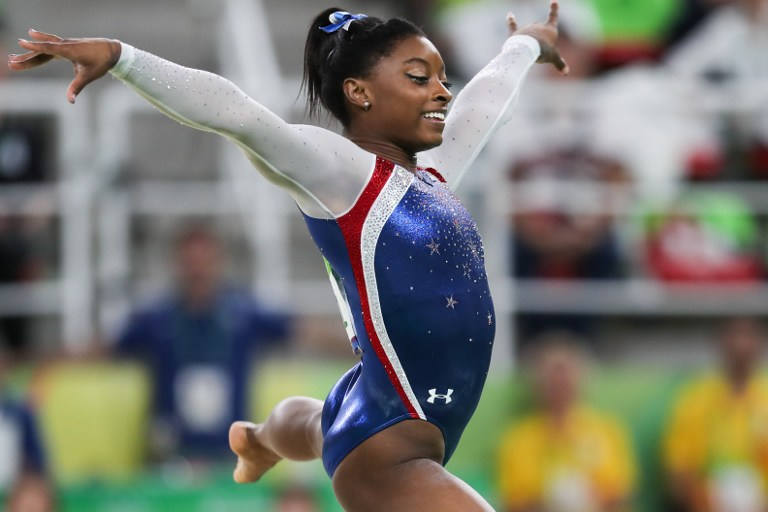 US gymnast Simone Biles competes during a floor exercise event of women's individual all-around of Artistic Gymnastics at the 2016 Rio Olympic Games (Photo by Zheng Huansong / NurPhoto)