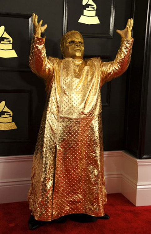CeeLo glows in gold (photo c/o AFP)