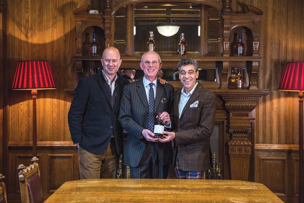 Quentin Job, Colin Scott and Deepak Ohri at the distillery in Scotland
