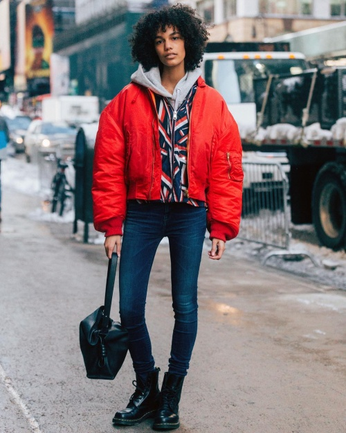 A bright red puffer on the streets of New York (photo c/o @melodiejeng)