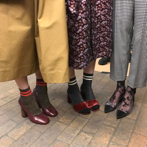 Creatures of Comfort models demonstrating one of the hottest looks of the season- bold socks (photo c/o @creaturesofcomfort)